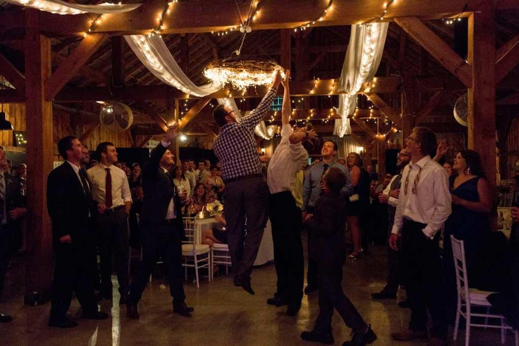 Garter toss scramble in barn reception venue