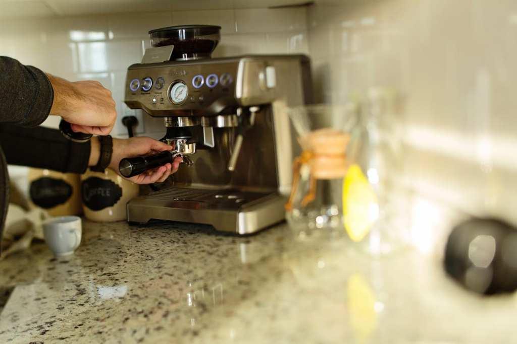 Couple making coffee in urban Cornwall loft apartment