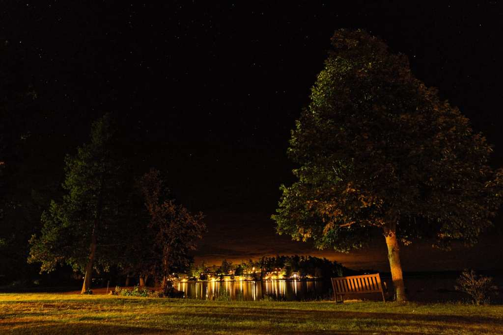 Calabogie Lodge at night from Barnet Cottage at intimate lakeside wedding