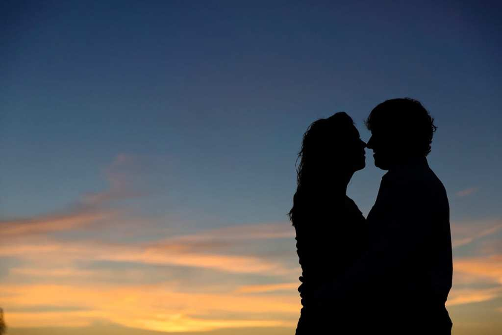 Silhouetted sunset couple in Martintown engagement shoot