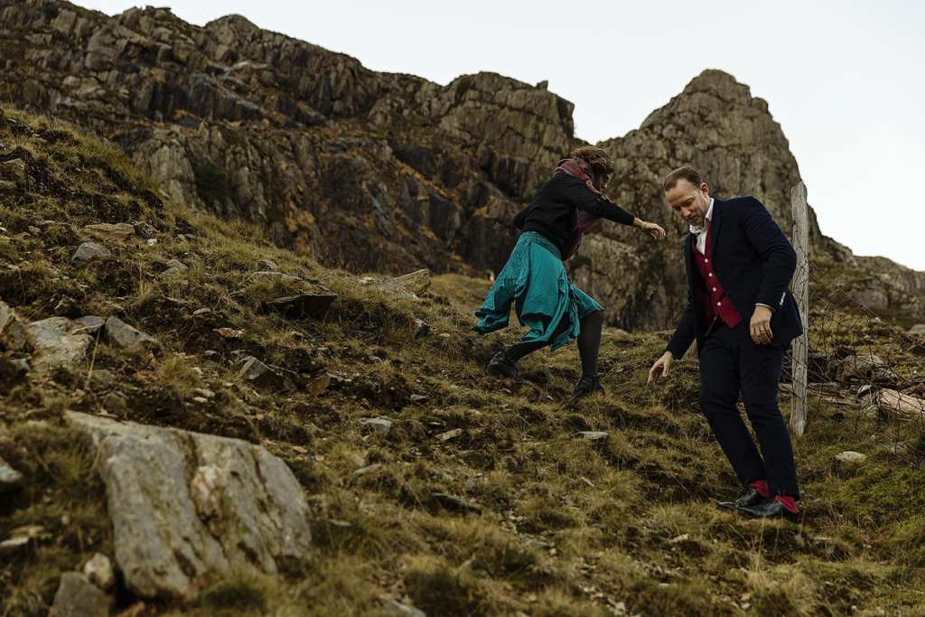 couple scramble down mountain in Snowdonia