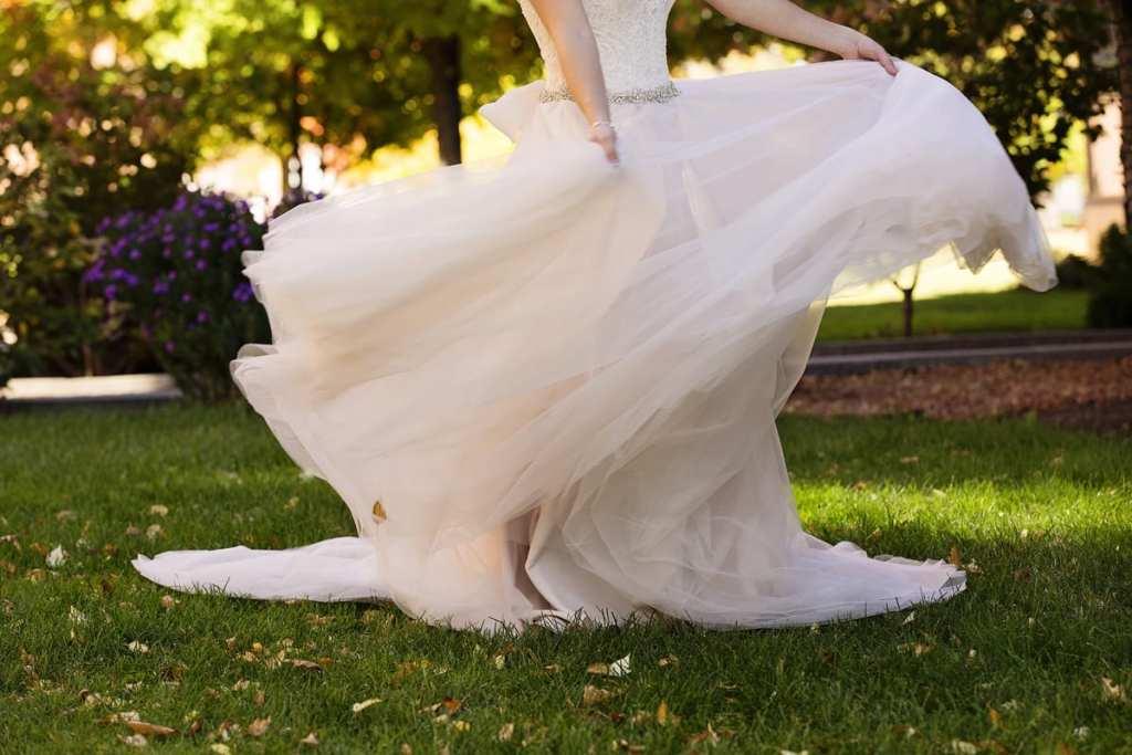 bride swirls blush wedding gown