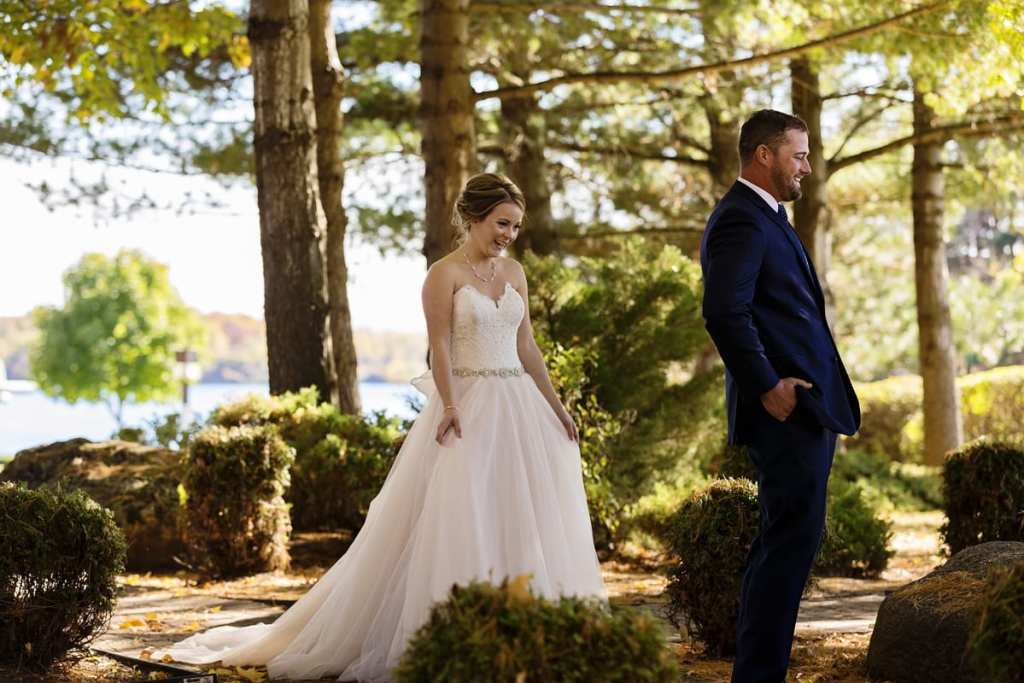 bride and groom look excited right before seeing each other for wedding first look