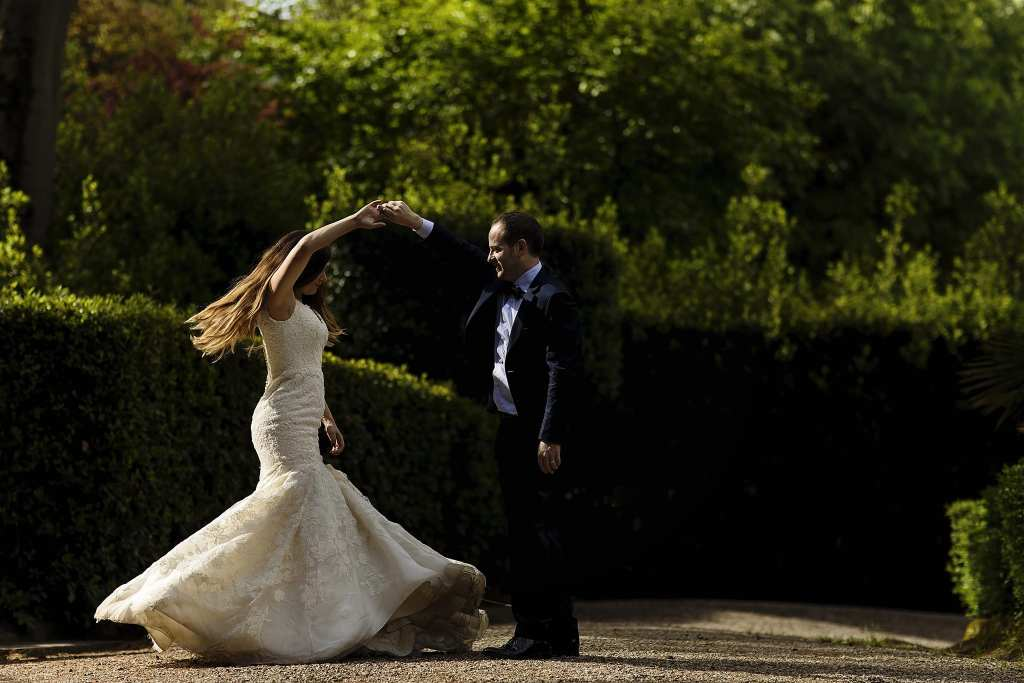 groom twirls bride wearing fit and flare gown during session with Ontario & Destination Wedding Photographer