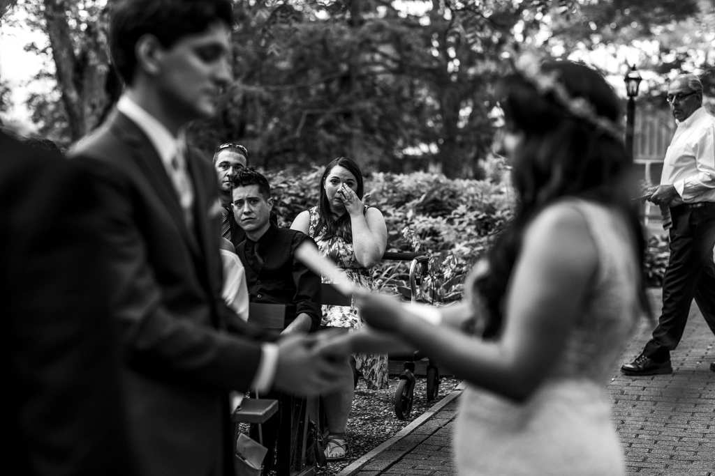 guest wipes eyes during Strathmere wedding vows