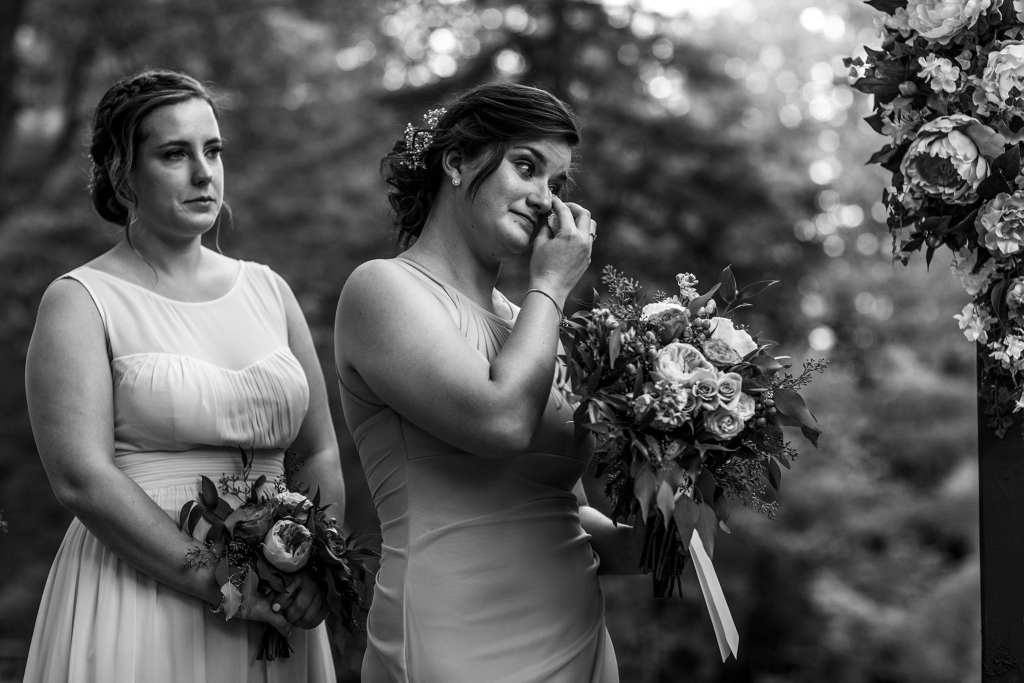 bridesmaid wipes eyes during Strathmere wedding ceremony
