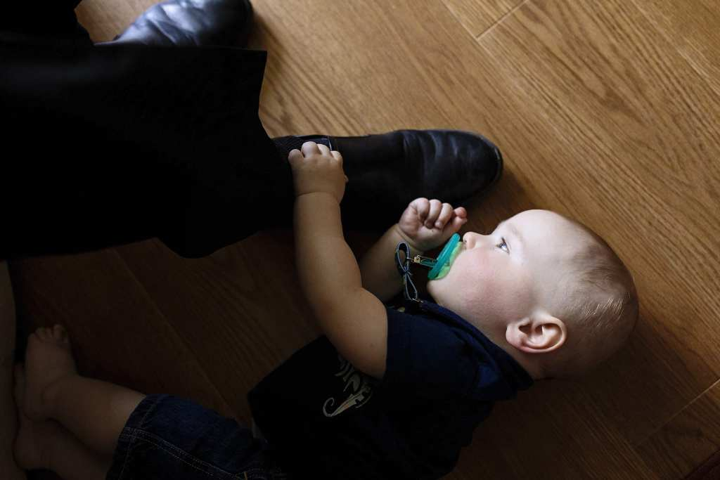 grandson plays with grandpa's shoe