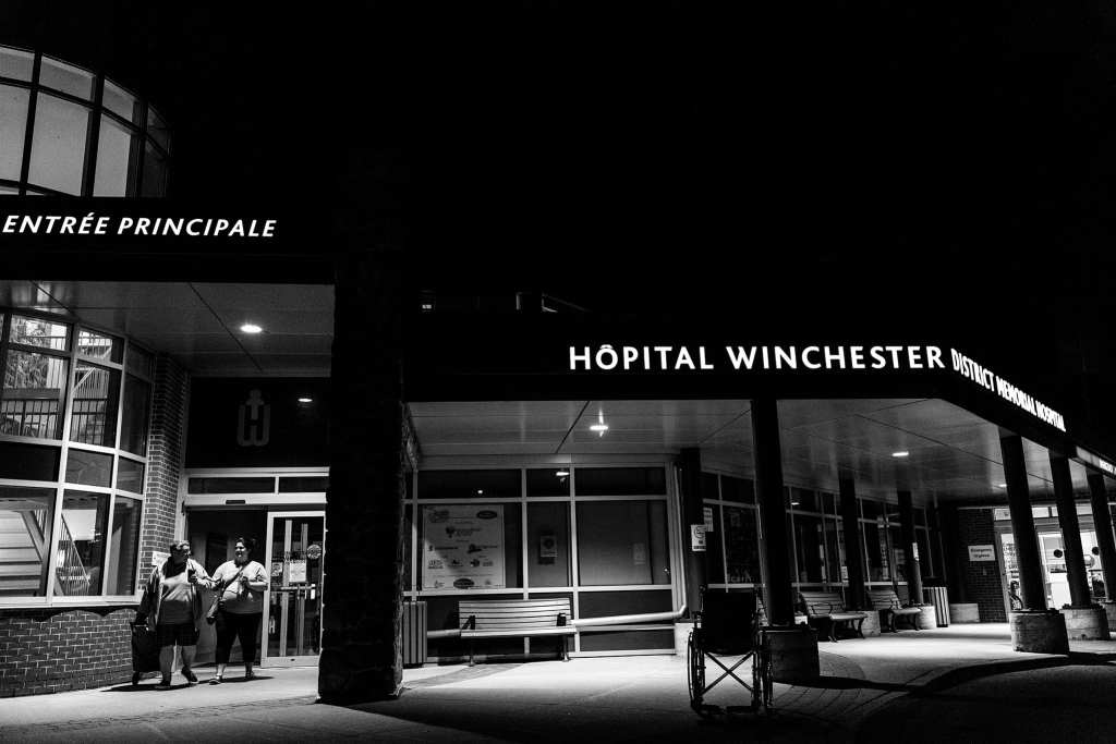 nighttime shot of exterior of Winchester District Hospital