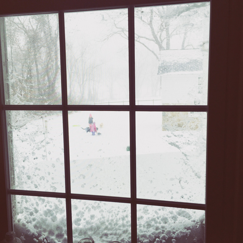 Kids: In the blizzard. Me: Inside with oatmeal, coffee and knitting.
