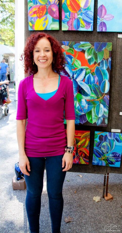 Monika Ruiz with her paintings
