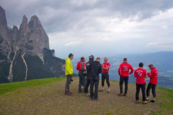 Pilots contemplating the conditions for paragliding in Alpe di Suisi (Seiser Alm)
