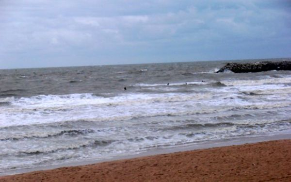 Surfers braving the cold waters of the North Sea