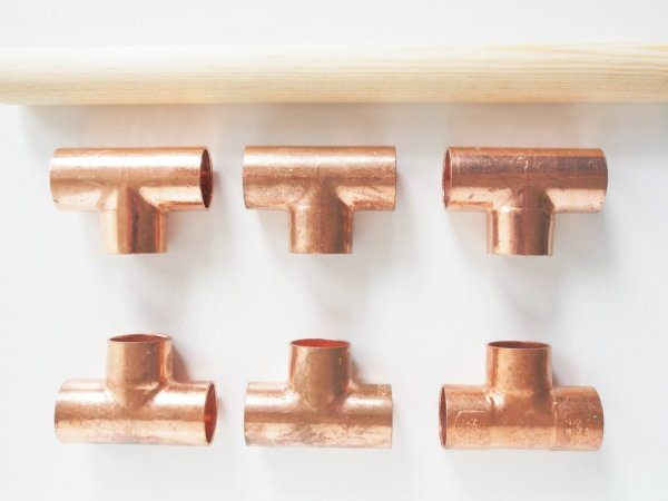 You'll need following:  Round stick and copper fittings, remember to measure the diameter. A saw and glue.
