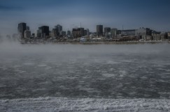 Montreal skyline with rising steam fog