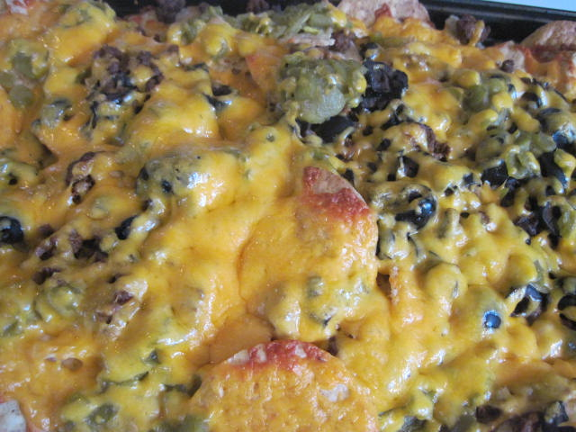 ... meat, chopped black olives, green chile's, shredded cheddar cheese