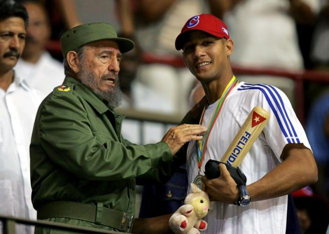 File picture of then-Cuban President Castro handing out a baseball bat to Cuban player Gourriel in Havana