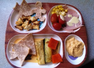 Hummus and carrot filled tortillas, roast veg, ham, tomatoes and more hummus!