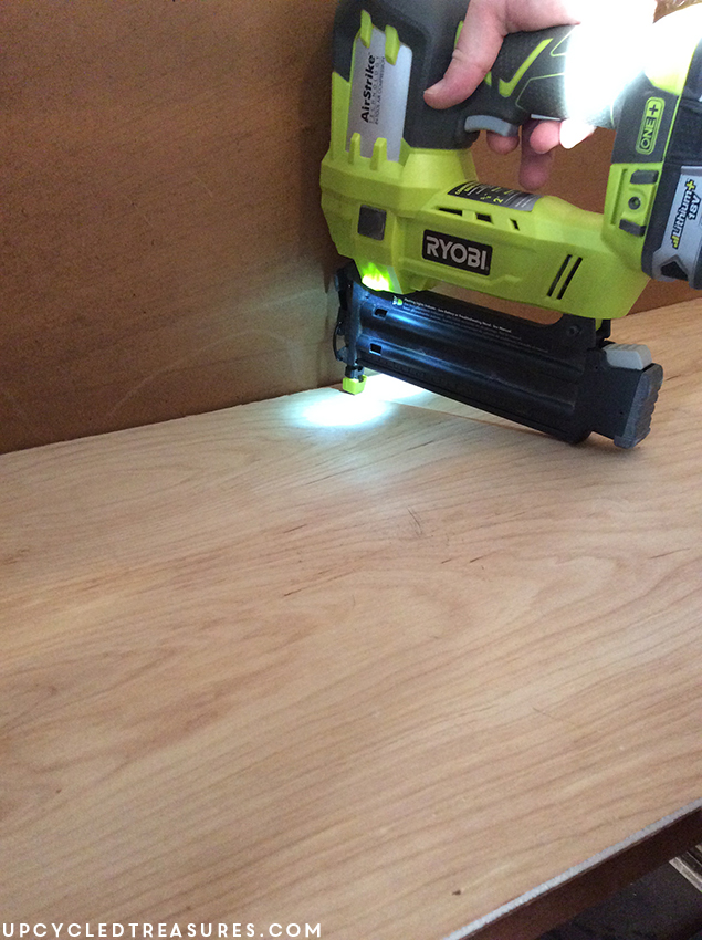 using-ryobi-nail-gun-to-attach-plywood-inside-armoire-upcycledtreasures