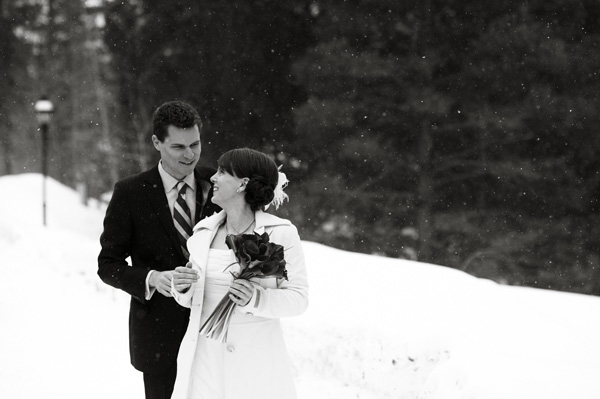 Black and white snowy mountain bride and groom