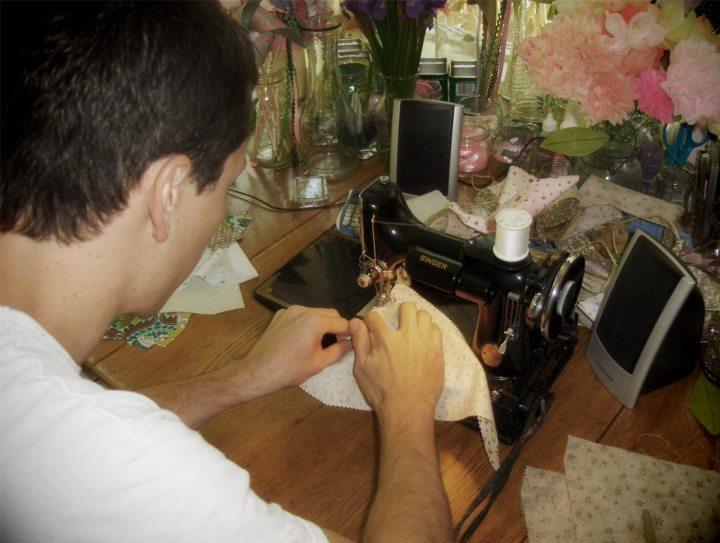 Hindsight Groom sews bunting