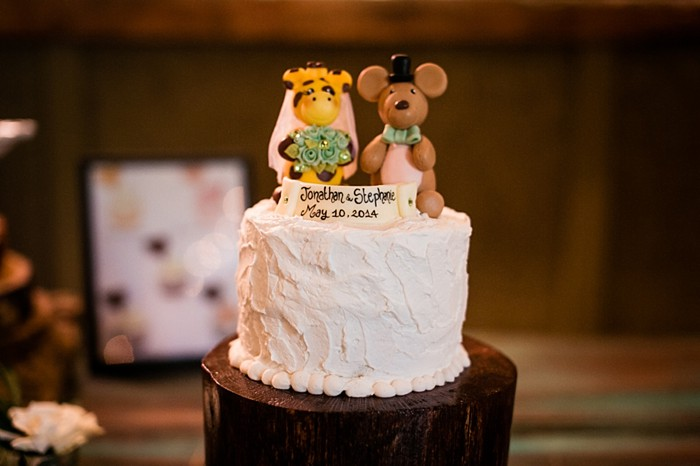 wedding cake with giraffe and kangaroo topper western North Carolina handmade wedding by Shutter Love Photography