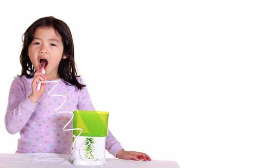 girl using a waterpik kids flosser