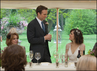 "Rafe Spall and Rose Byrne at a wedding in Dan Mazer's comedy ""I Give It a Year"""