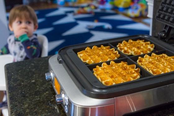 Baby P is eyeballing those waffles already!