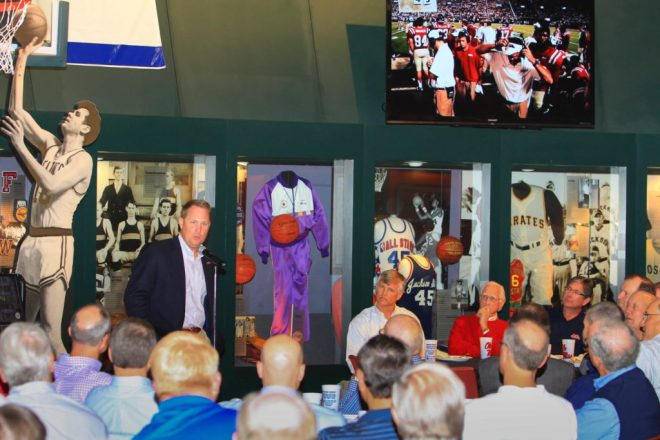 Hugh Freeze speaks at an Ole Miss alumni gathering with one of our 80-inch high-def screens in the background.
