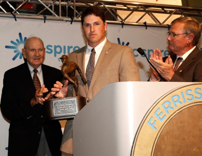 Boo Ferriss (left) looks on as Hunter Renfroe accepts the 2013 Ferriss trophy. Ferriss has enjoyed this post-season run by his alma mater. (Photo by Ed Gardner)