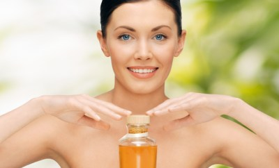 beautiful woman with oil bottle
