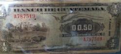 Moneda - 50 centavos - foto por Manuel Flores