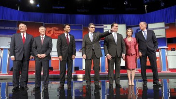 Republican presidential candidates pose before the start of a Fox-sponsored forum for lower polling candidates held before the first official Republican presidential candidates debate of the 2016 U.S. presidential campaign in Cleveland