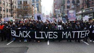 Dec. 13, 2014 - New York, NY. Thousands of protestors march in Millions March NYC, a massive protest against police brutality. Photo by Julius Motal for Voices of NY