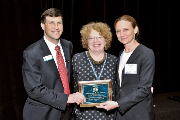 PHOTO: The Garden's emeritus Vice President of Community Education Programs Patsy Benveniste and CEO Sophia Shaw receive the award for Program Excellence from Dr. Casey Sclar, Executive Director of APGA.