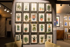 Booth #104, Dinan & Chighine: A set of 18th century botanical prints finished with watercolor in etched Greek key-design frames.