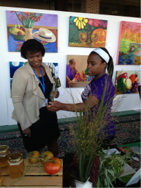 PHOTO: GYF student Tatiana talking with a guest about the farm's honey.
