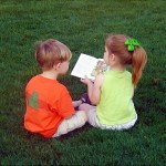 PHOTO: Kids reading outside.