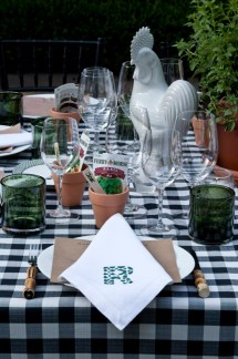 Fresh herbs, terra cotta pots and seed packets grace the table top for a summer pizza party at Boxwood, the Atlanta residence of Danielle Rollins.