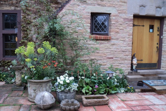 PHOTO: A collection of stone troughs comprise a patio container garden.