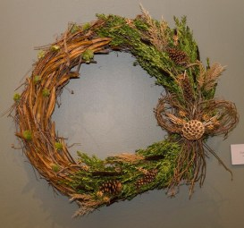 PHOTO: Wreath created from millet, with evergreens, carex seedpods, a lotus pod and a creeper vine bow.