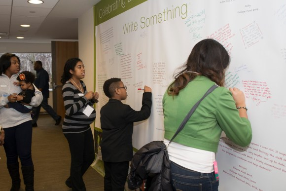 PHOTO: College First participants shared their thoughts and feelings on a mural outside the auditorium.