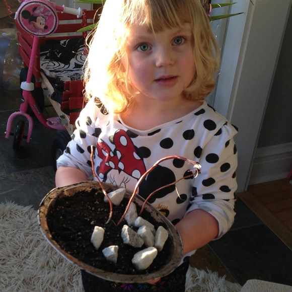 PHOTO: Laila holds her finished mudpie.