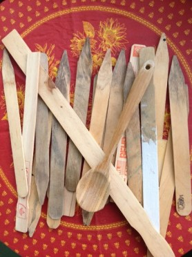 BEFORE:  Clean out the paint shelf! Old paint stirrers, stakes, and even wooden spoons can work as plant markers.