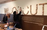 """It took 1,022 wood """"cookies,"""" 3 people, and 3 blisters to install the exhibition's title."""