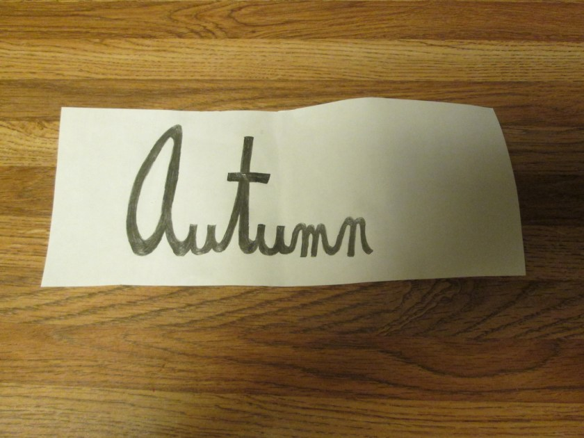 Today I used a pencil to write the word autumn in cursive block letters.