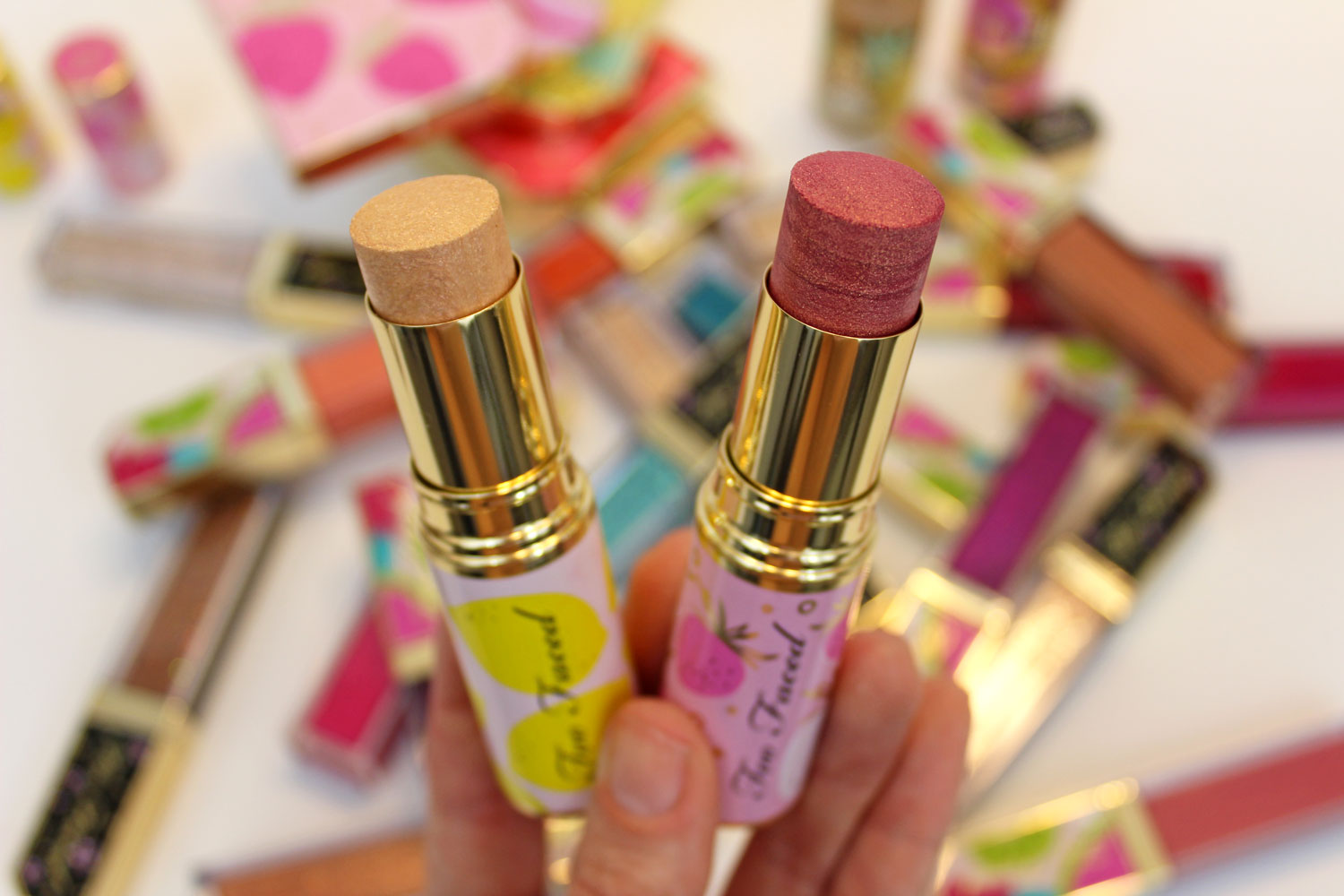 Too Faced Tutti Frutti Frosted Fruits Highlighter Sticks review and swatches by cruelty free blog My Beauty Bunny