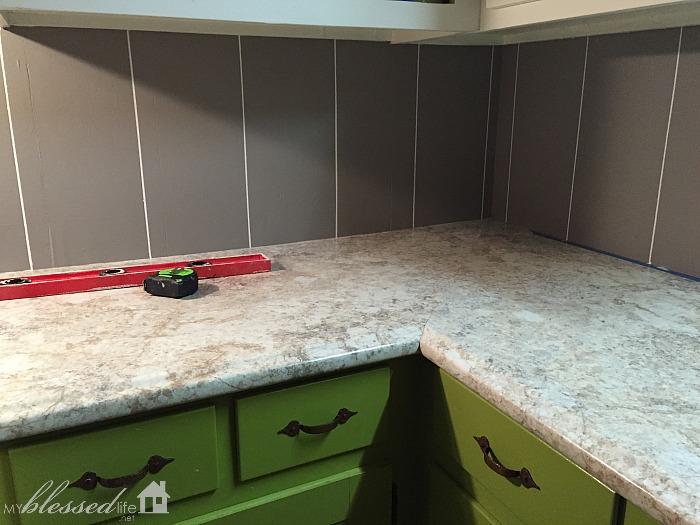 measure divide equal vertical rectangles tape kitchen tile backsplash