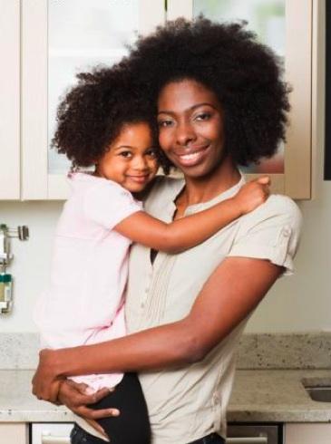 Black Mother Hugging Child