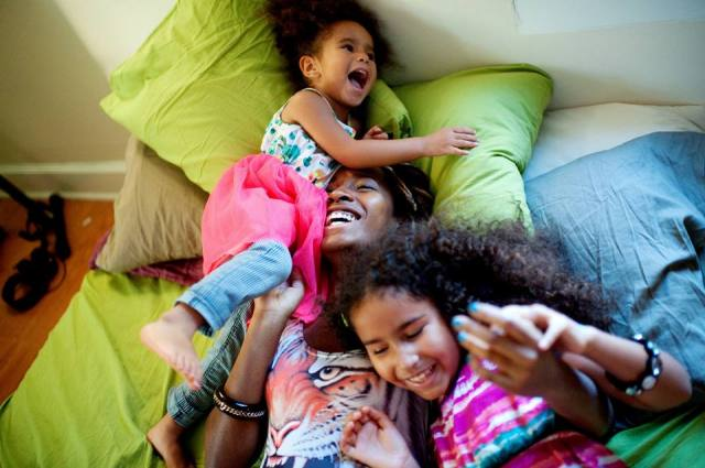 Black Mom Laughing With Kids